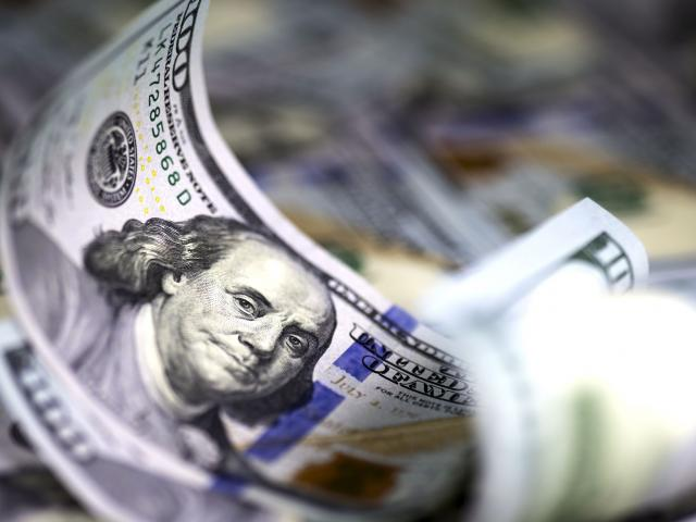 Dollar slipping, stocks bid