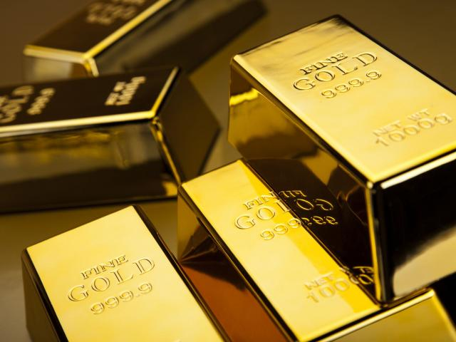 Gold soars as Fed sounds warnings on asset prices, US recovery